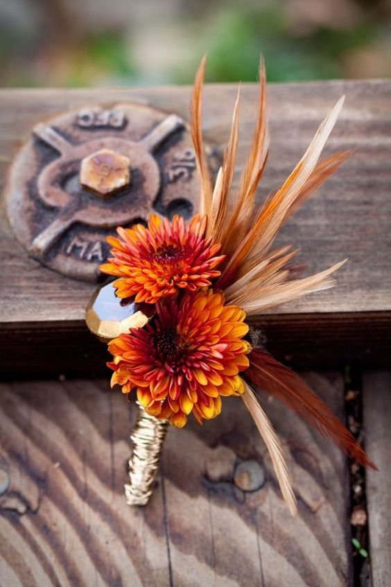 chrysanthemum and feather boutonniere - via mywedding.com