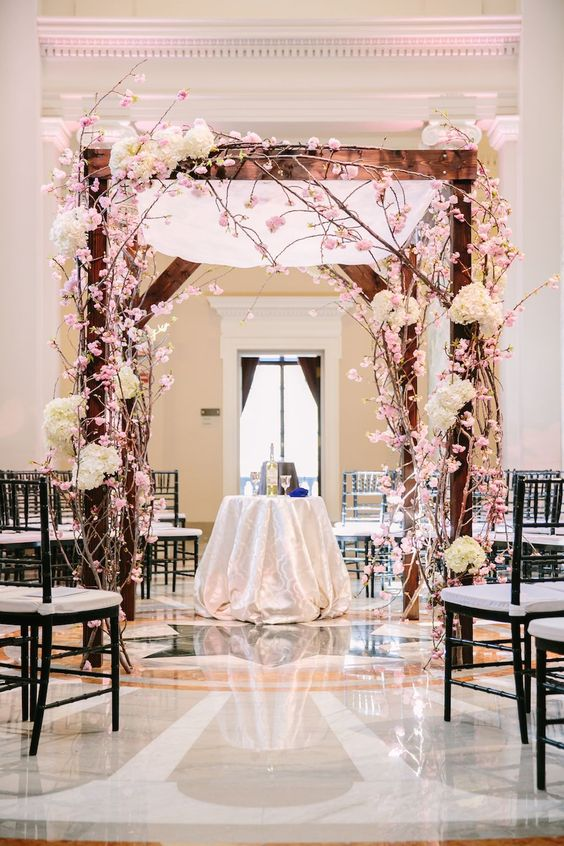 wedding arch with cherry blossoms and hydrangea - via washingtonian.com
