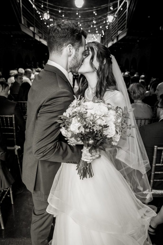 Sara & Mitch Wedding - Bride and Groom Kissing - The Foundry - Craig Paulson Studio