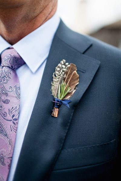 feather boutonniere - via stylemepretty.com