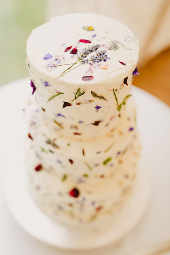 Edible Pressed Flower Wedding Cake - via whimsicalwonderlandweddings.com