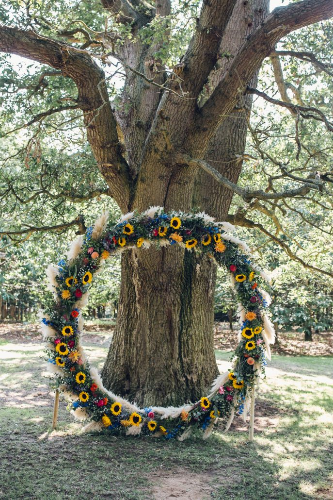 Sunflower Moon Gate Flower Arch - via whimsicalwonderlandweddings.com