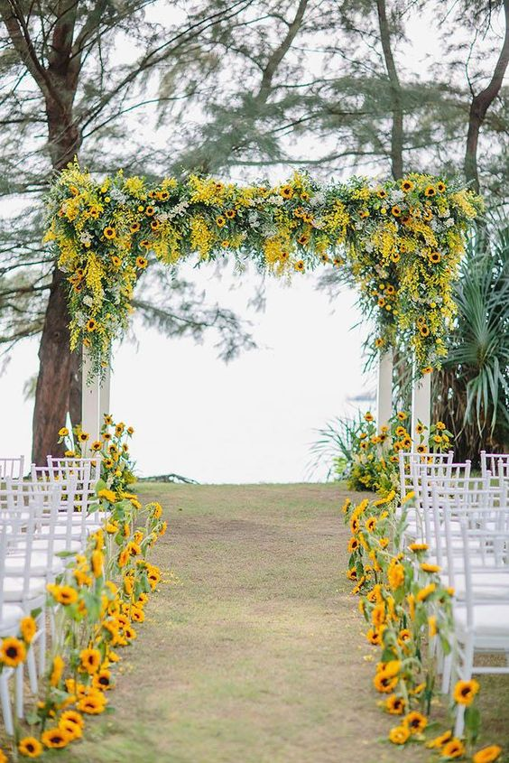 Sunflower Wedding Arch - via weddingforward.com