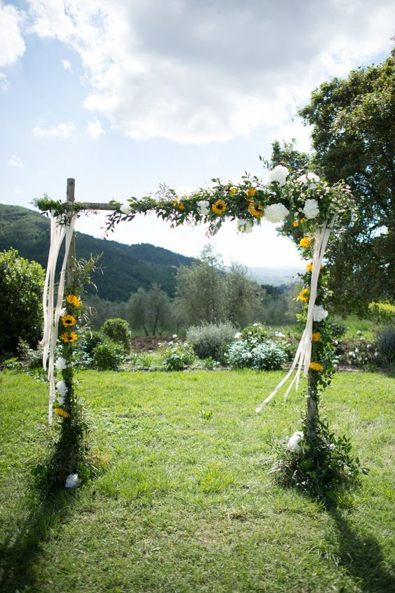 Sunflower Wedding Arch - via whimsicalwonderlandweddings.com