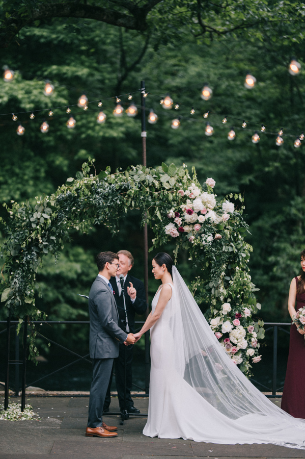 Jewel and Daniel Wedding - floral archway - Stone Mill New York Botanical Garden - Josh Mccullock