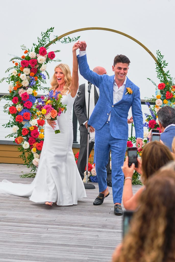 Dayna and Matt Wedding - Bride and Groom Bouquet Moon Gate Flower Arch - Gurney's Montauk - Andreas and Nico