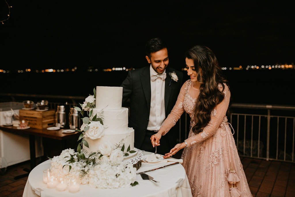 Nailah and Hasan Wedding - Bride and Groom Cutting Cake - Liberty Warehouse - Jenna Cavanaugh Photography