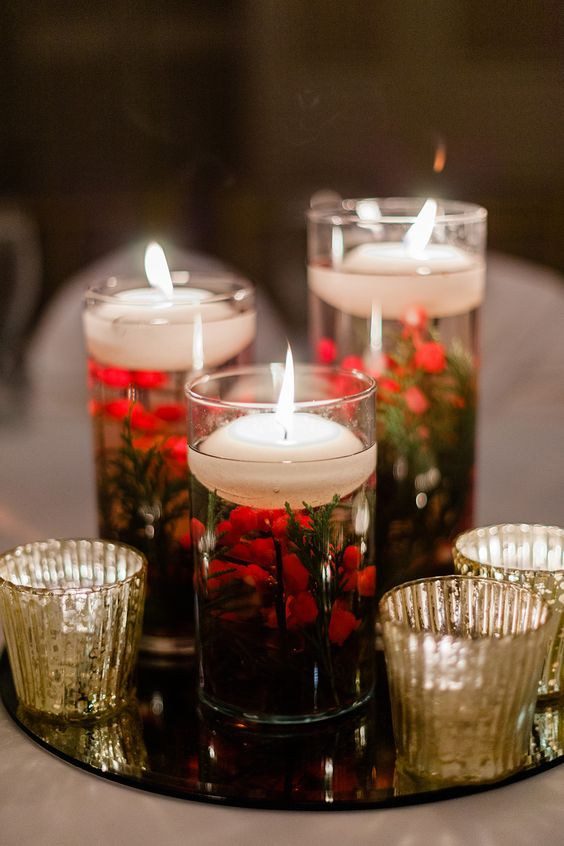submerged flowers floating candles winter wedding centerpiece - via dreamyelk.com