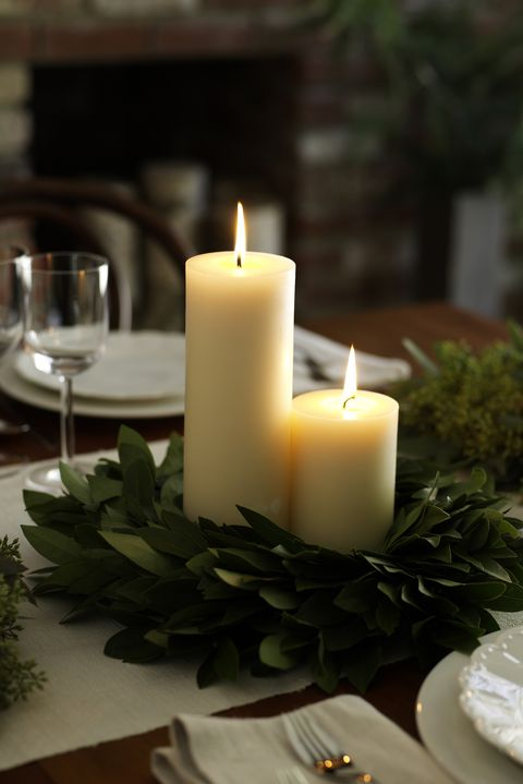 candle and bay leaves wreath winter centerpiece - via elledecor.com