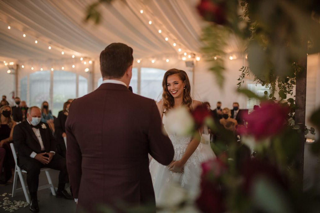 Cara and Vince Wedding - Bride and Groom Exchanging Vows - Laura Huertas Photography