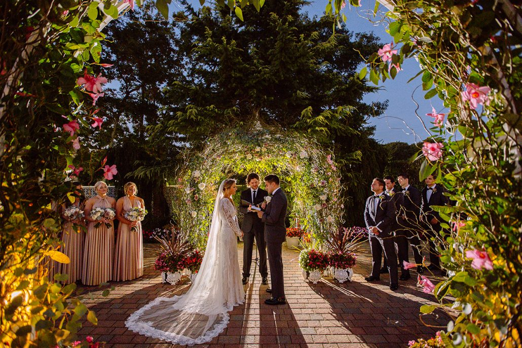 Alyson & Gary Wedding - Rose and Eucalyptus and Curly Willow Ceremony Floral Arch - The Estate at East Wind NY - Kate Neal Photography